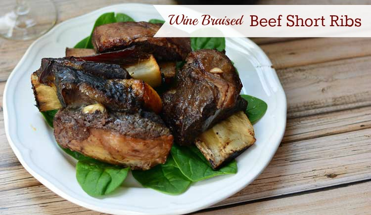Braised in a red wine marinade all day in a slow cooker, beef short ribs fall right off the bone. Serve this delicious meal for company.