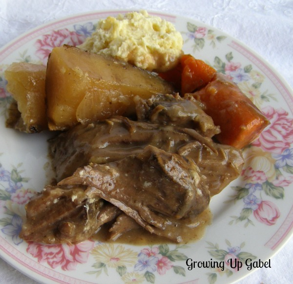 Slow Cooker Pot Roast Recipe with Biscuit topping from http://growingupgabel.com @thegabels #recipe