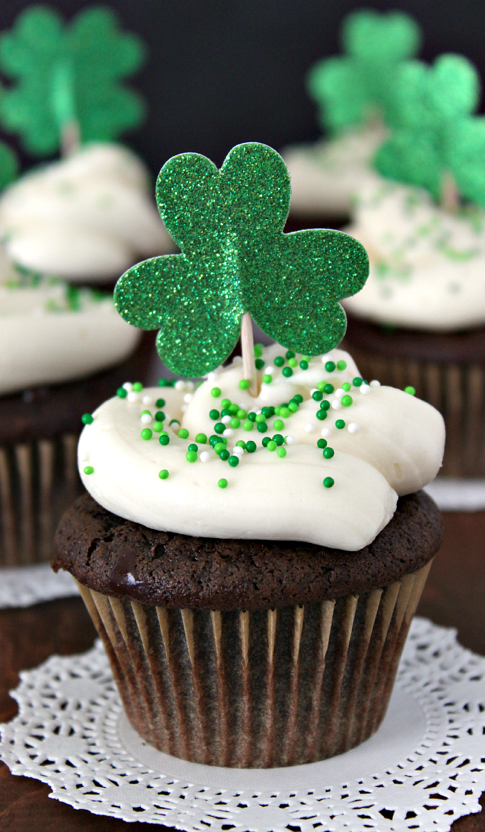 Irish Car Bomb Cupcakes take a popular St. Patrick's Day drink and turn it into an amazing dessert. Rich chocolate cupcake filled with gooey, dark chocolate ganache, and topped with Irish cream cheese frosting. Nothing will impress your guests more this holiday! || via growingupgabel.com #irish #cupcakes #stpatricksday
