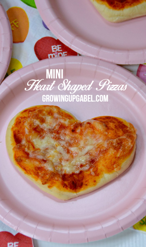 Looking for a fun Valentine's Day recipe to make with the kids? Check out these easy mini heart shape pizzas made with cookie cutters!