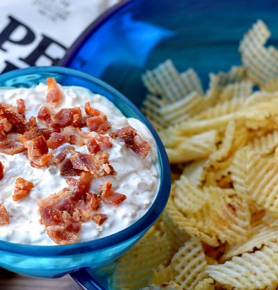 Need a delicious pot luck recipe? Look no further than this homemade potato chip dip. Made with sour cream, caramelized onions and bacon, you'll always bring home an empty dish.
