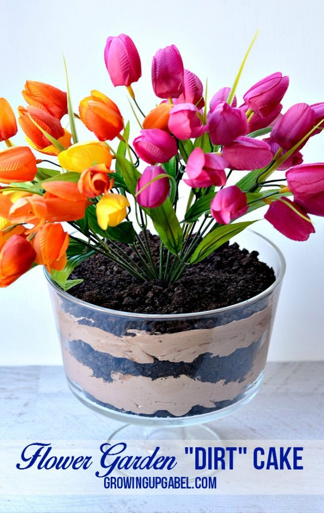 Discover how to make a dirt cake that is both yummy and elegant! This chocolate dirt cake is served in an elegant footed serving dish and topped with bright spring flowers for a centerpiece that is both gorgeous and delicious!