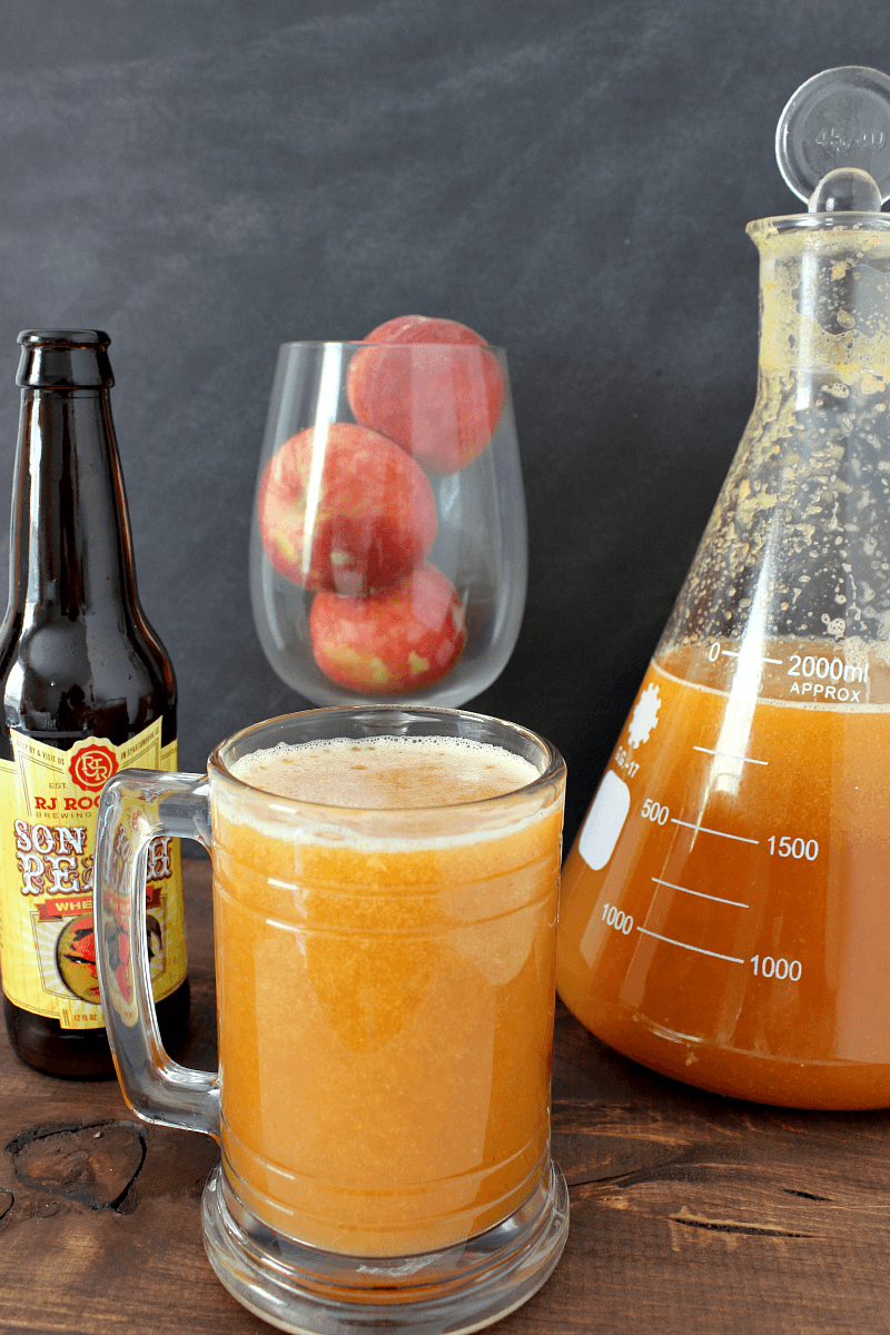Peach Beermosas --- Peach beermosas are a refreshing, fun, and interesting summer drink. They're bound to be a conversation starter at your next barbecue! || via growingupgabel.com #peach #beer #beverages #drinks #recipes #beermosas #cocktails #summer #outdoors #entertaining #party #barbecue