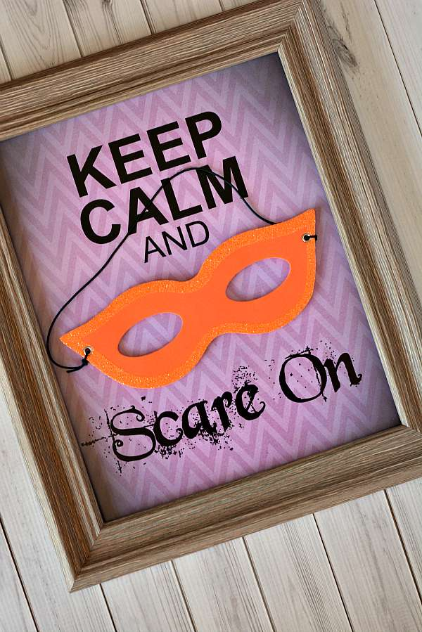 An easy to create Keep Calm poster that's perfect for Halloween! Just add a craft mask to our free Keep Calm poster printable and pop in to a frame! This Halloween decoration is ready for your Halloween party in under 10 minutes!