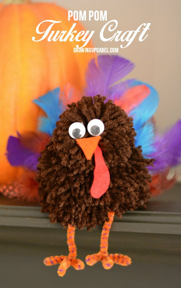 This adorable pom pom craft is the perfect kids Thanksgiving craft! Homemade pom poms are made in to a turkey and embellished with feathers, legs and a face! An adorable Thanksgiving craft!