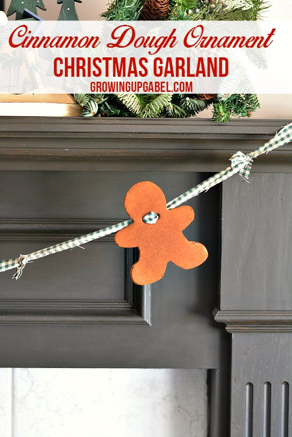 Homemade Christmas decorations are the best and this easy Christmas garland smells as good as it looks! Cinnamon dough ornaments are strung together on fabric to make rustic and fun Christmas decoration that will last for years to come.