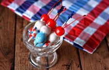 A fourth of July dessert is made even more fun with white chocolate, cherries and sprinkles!