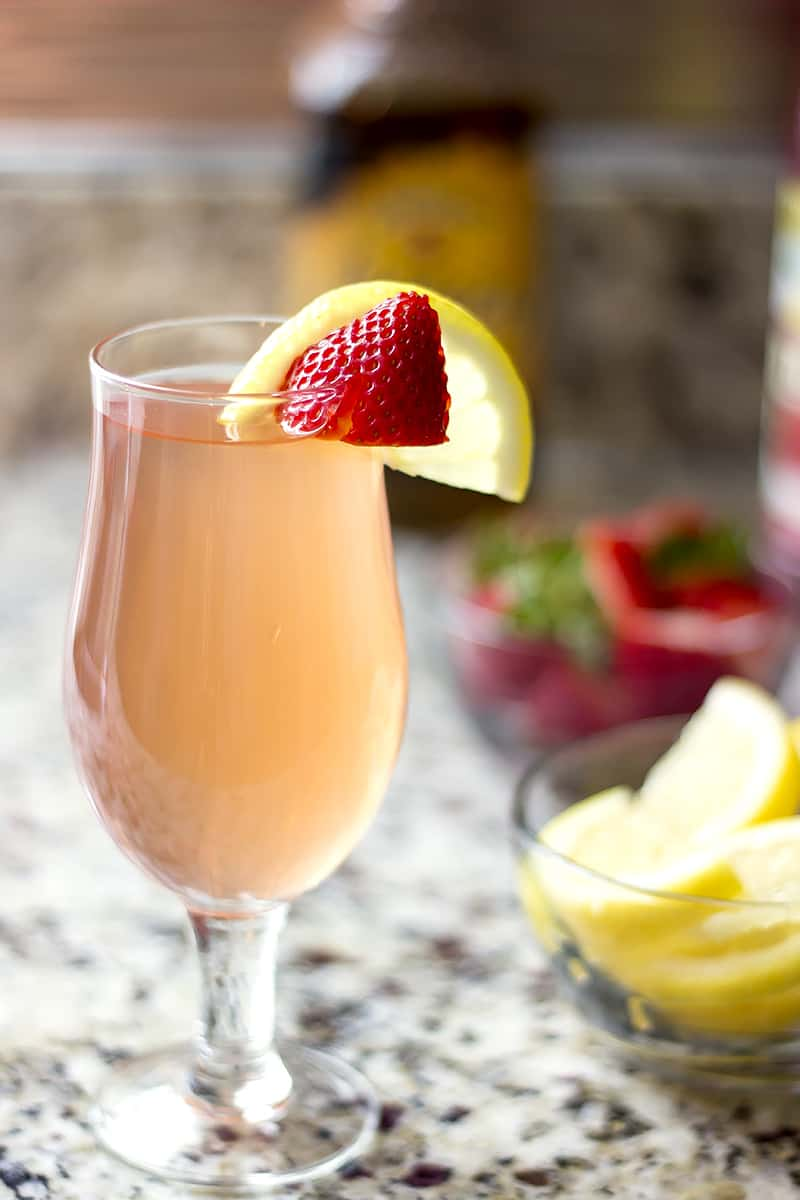 Strawberry lemonade bourbon cocktail recipe is only two ingredients! Just mix and drink for an easy summer cocktail.