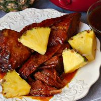 Pineapple glazed ham cooked in the Crock Pot is served with fresh pineapple on the side. Great for Easter!