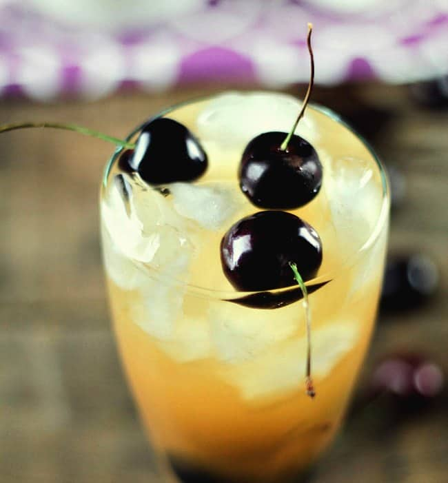 Black cherry hard lemonade is an easy to make cocktail perfect for hot summer nights.