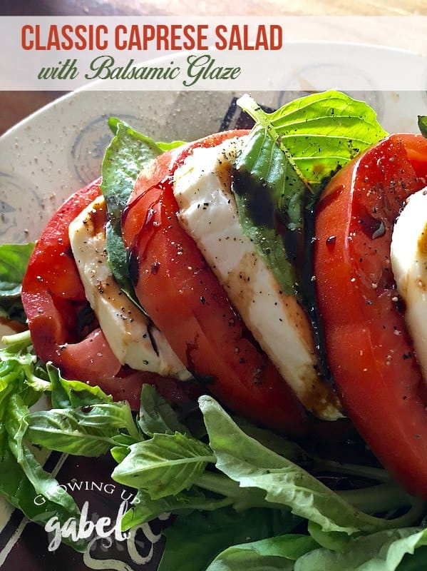 Caprese salad with balsamic reduction sounds fancy but it is simple to make. Layers of tomatoes, mozzarella and fresh basil are drizzled with olive oil and a homemade balsamic vinegar reduction. Perfect for dinner, lunch or parties!
