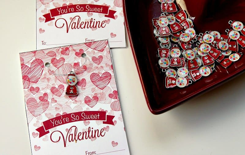 Handmade kids valentines cards include a handmade necklace.