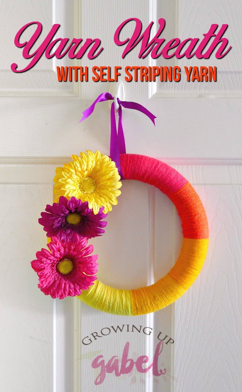Make a DIY spring or summer yarn wreath with fun self striping yarn! CLICK HERE for the easy tutorial and more yarn craft ideas!