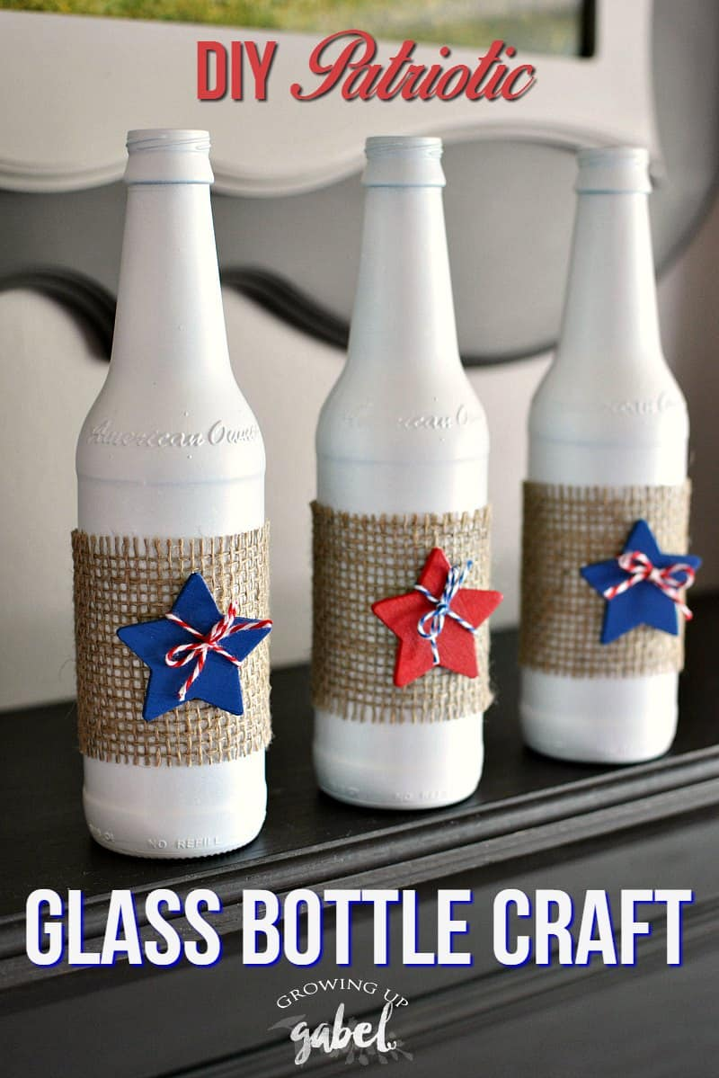 Glass upcycle bottles make great craft projects! Use empty beer or wine bottles, paint, and red white and blue embellishments!