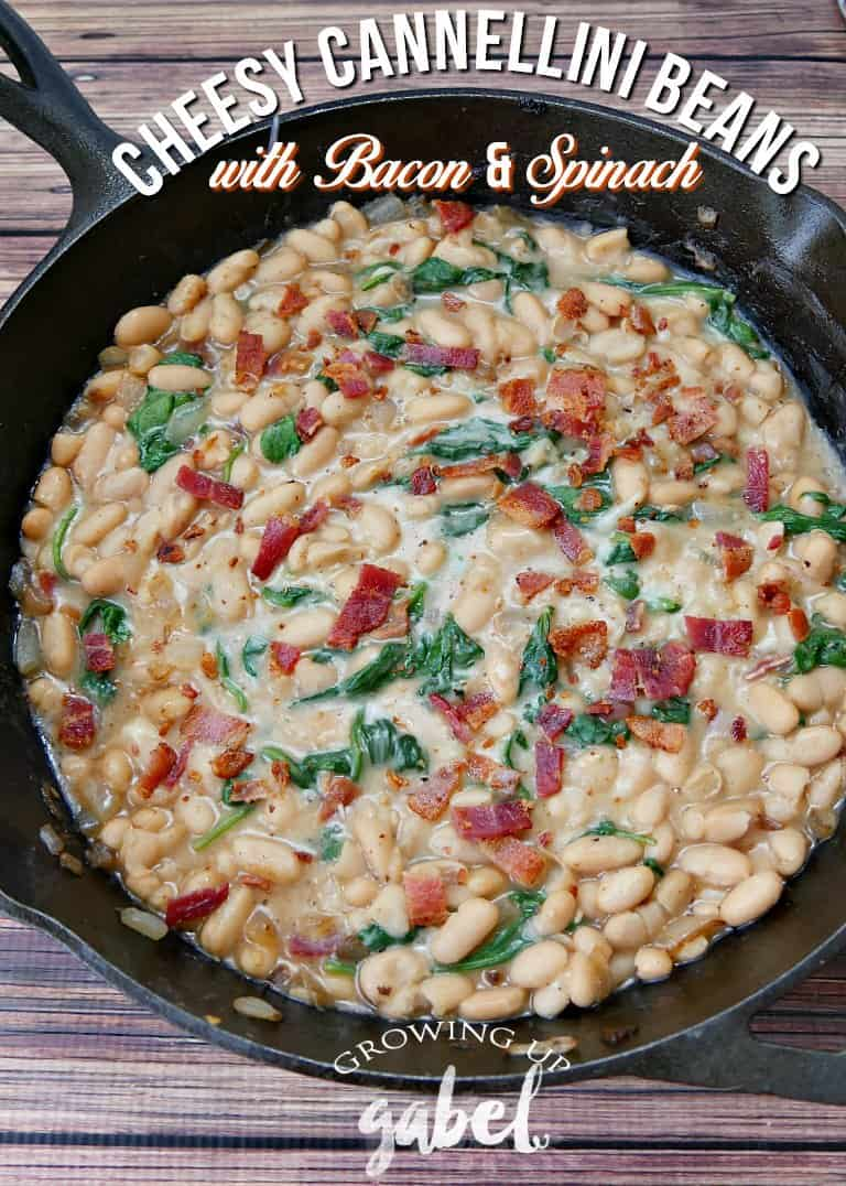 Turn 2 cans of cannellini beans into a delicious side dish! This cannellini bean recipe is made with bacon, onions, garlic and spinach for a delicious, healthy and cheap recipe!
