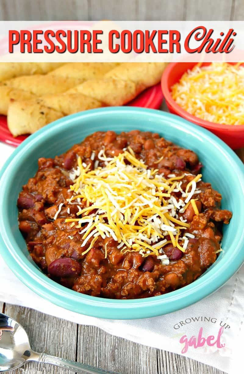 AD: CLICK NOW for THE BEST pressure cooker chili recipe you'll ever make in your Instant Pot! Made with ground beef and chili beans plus this is makes a thick hearty chili that's easy to make in an electric pressure cooker!  #InstantPot