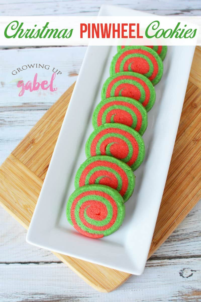 Festive red and green Christmas Pinwheel Cookies are fun and easy to make from a basic sugar cookie dough. Just roll, layer, slice and bake.