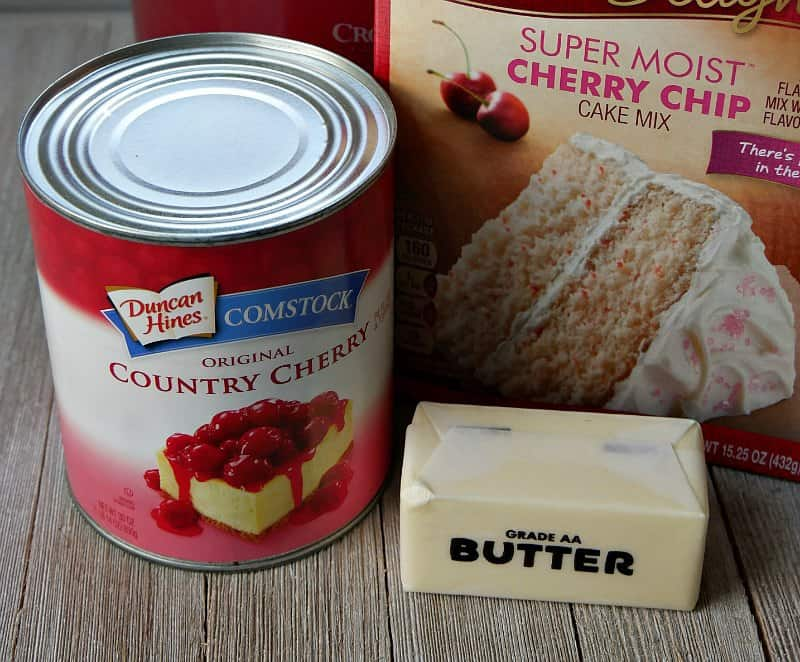 Can of cherry pie filling, a stick of butter and box of cherry chip cake mix