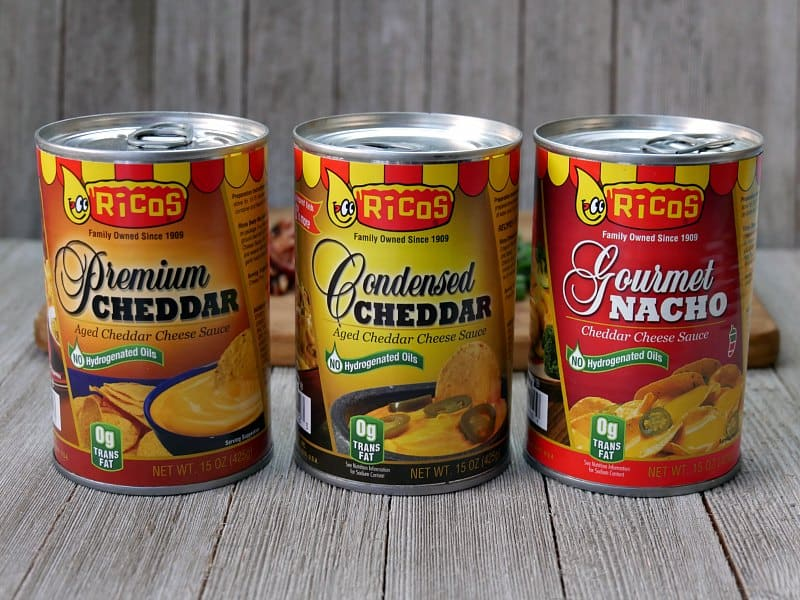 Cans of Ricos Premium Cheddar, Condensed Cheddar and Gourmet Nacho cheese