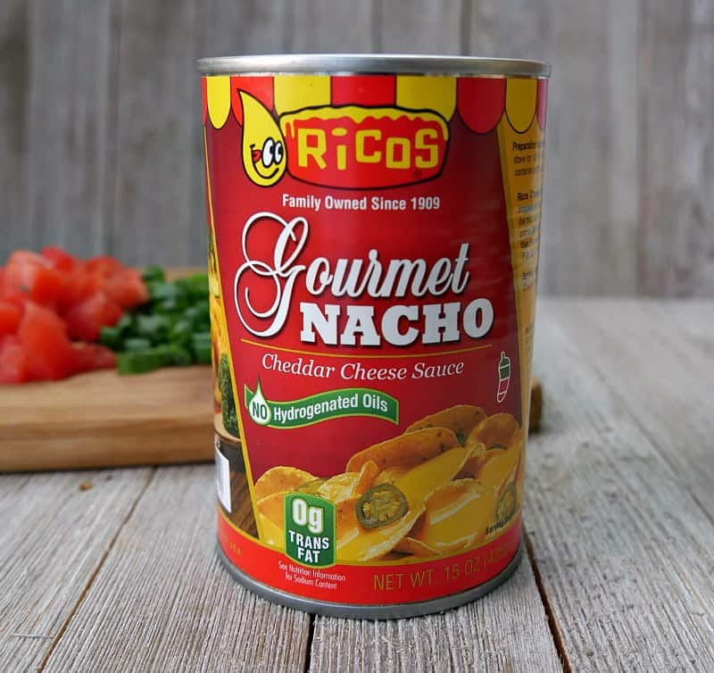 A can of Ricos Gourmet Nacho Cheddar Cheese Sauce which is the topping for making a Irish Nacho Recipe