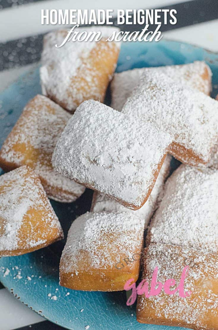 Make homemade beignets from scratch with a  yeast dough that is fried and then covered in powdered sugar.