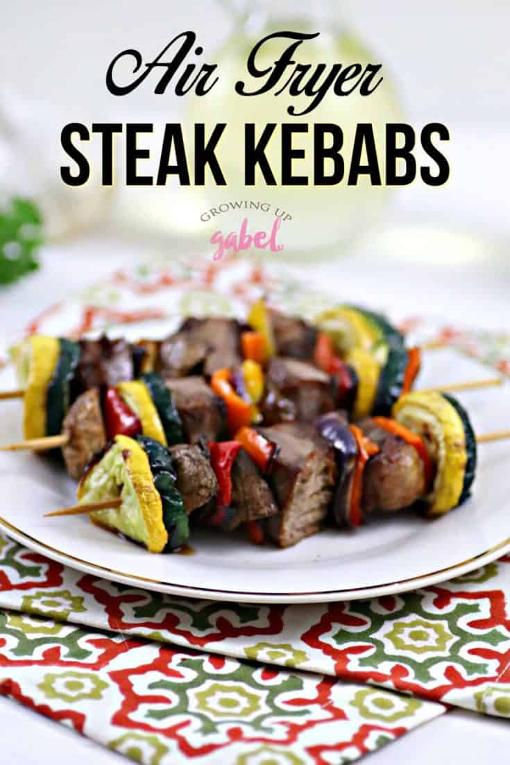 Make steak and vegetable kebabs in an air fryer! Marinade meat and veggies, then cook for a few minutes in an air fryer for a quick and easy dinner. #airfryer #kebabs #airfryerrecipes #steakrecipes #kebabrecipes