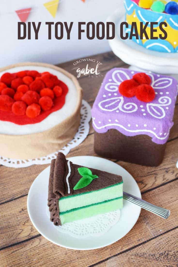Use a square tin or box, felt, pom poms and puffy paint to make this cute DIY Toy Food Cake.