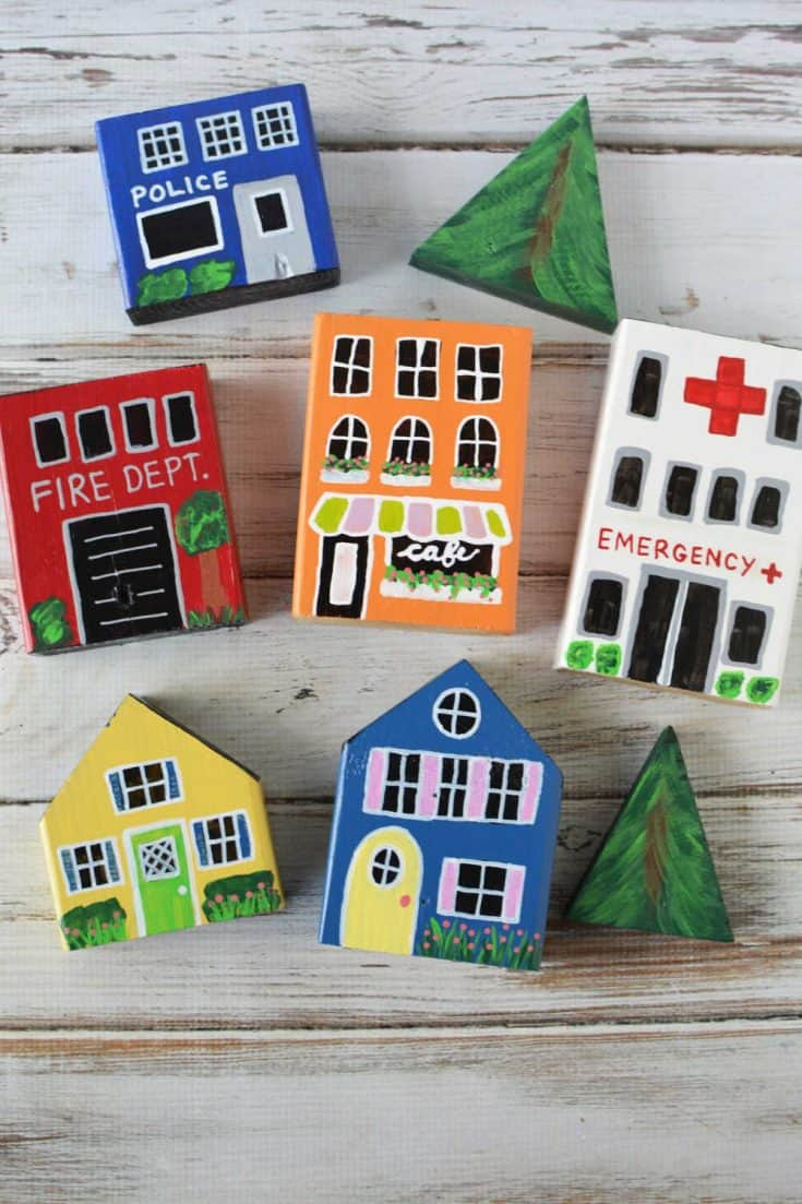 Turn scrap wood into a DIY wooden town play set for hours of creative fun!