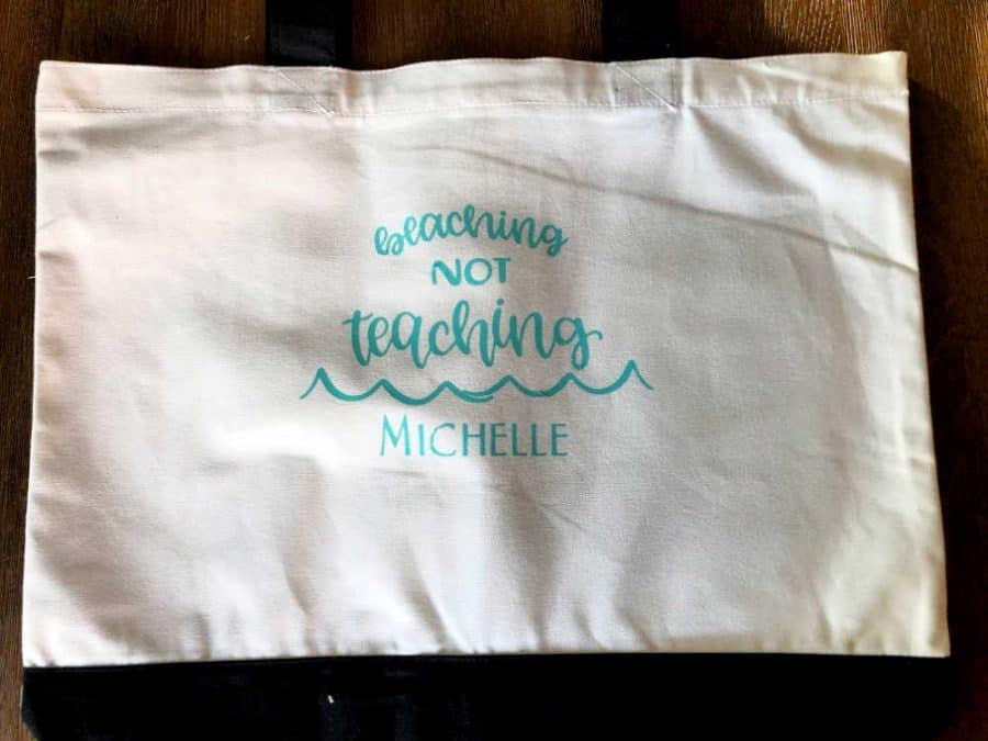 Finished Beaching Not Teaching tote bag on table