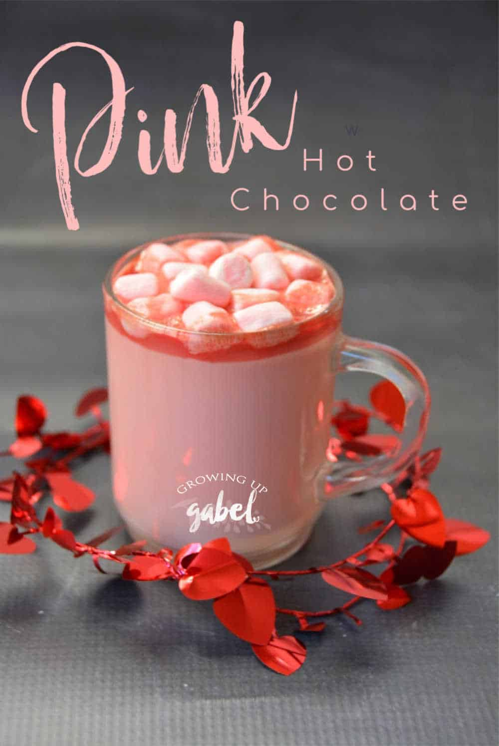 Cup of pink hot chocolate with marshmallows on top