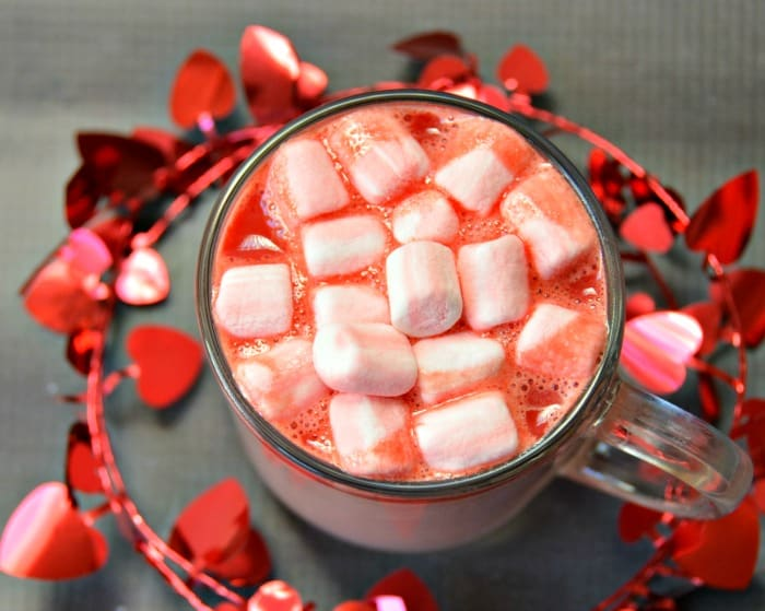 cup of pink hot chocolate with marshmallows taken from above