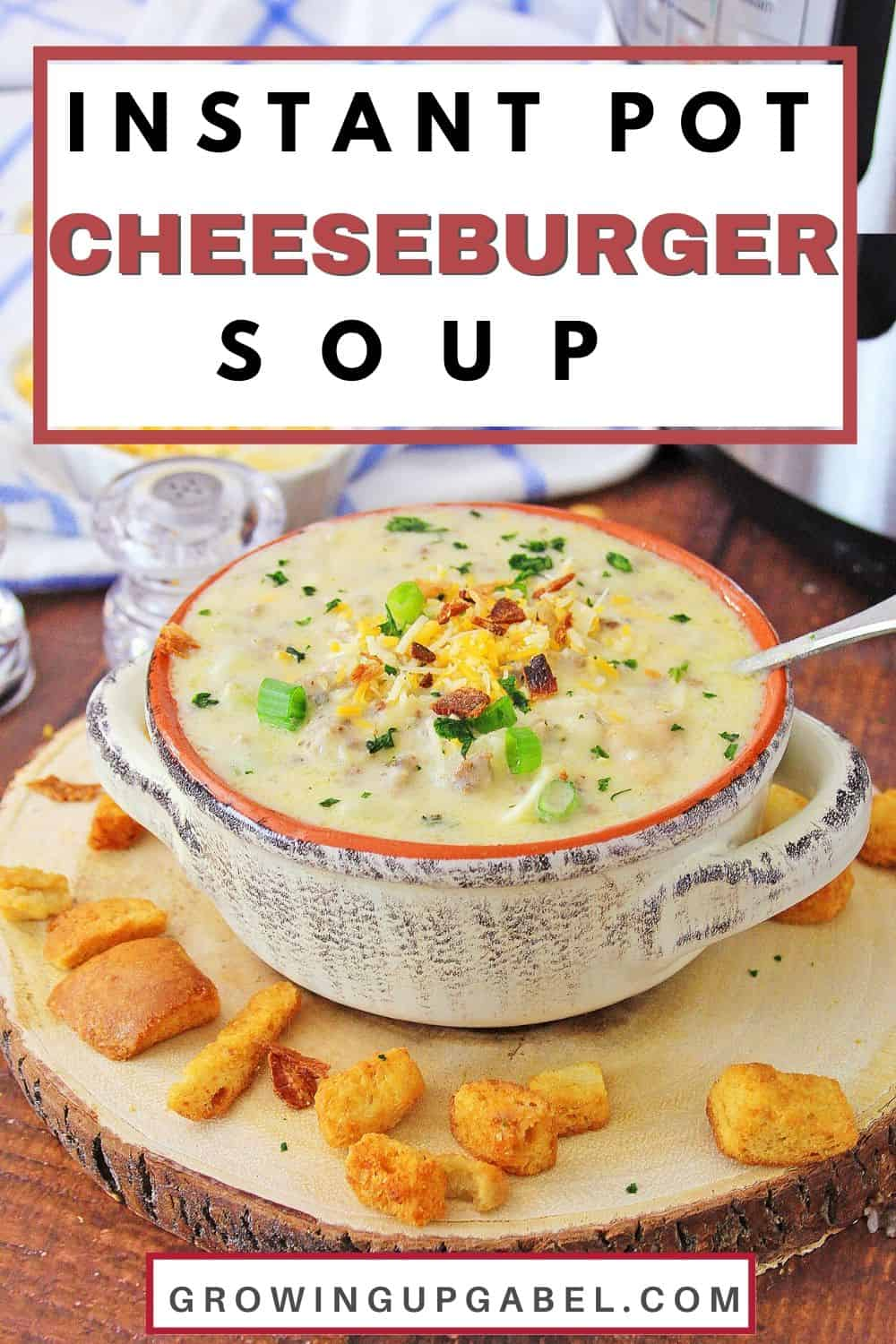 Instnat Pot cheeseburger soup in a bowl on a table with croutons