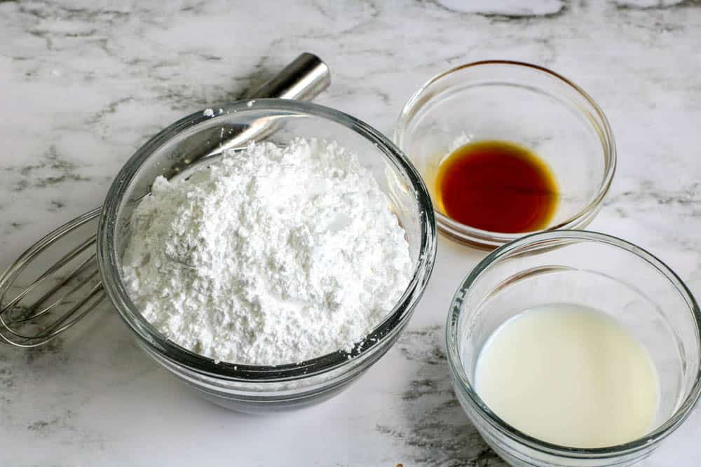 Powdered sugar, vanilla and milk in small bowls
