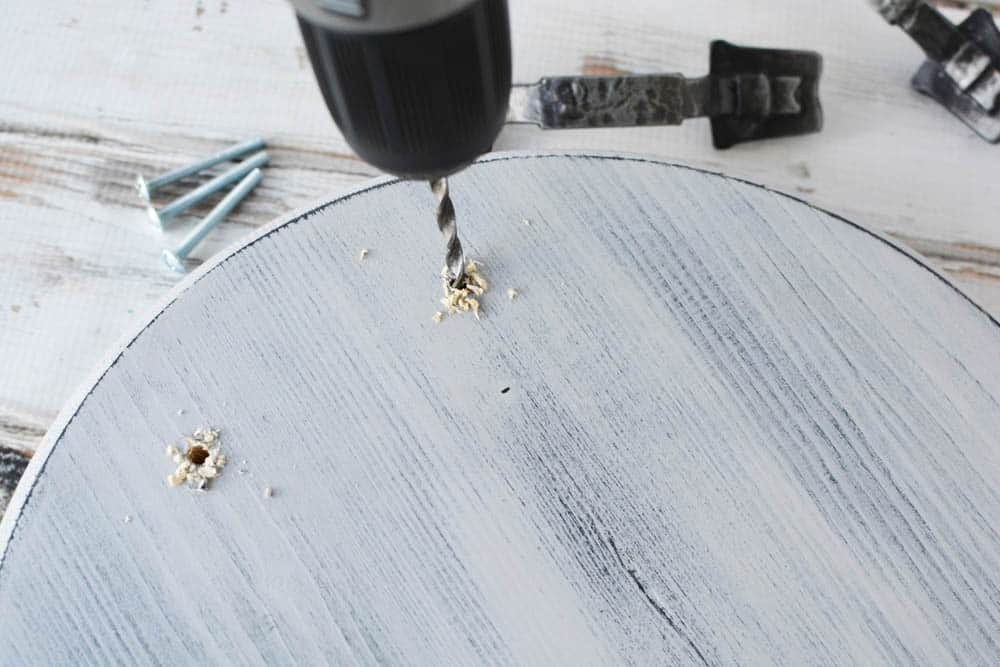 holes being drilled into a wood tray with a drill bit