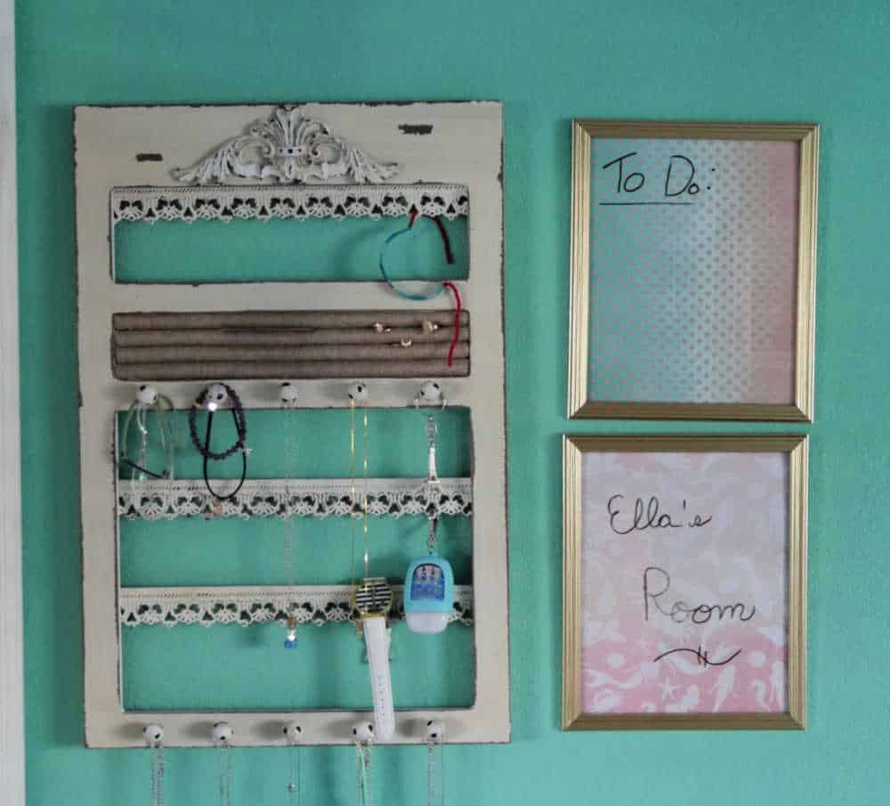 Jewelry holder and 2 dry erase boards on a wall