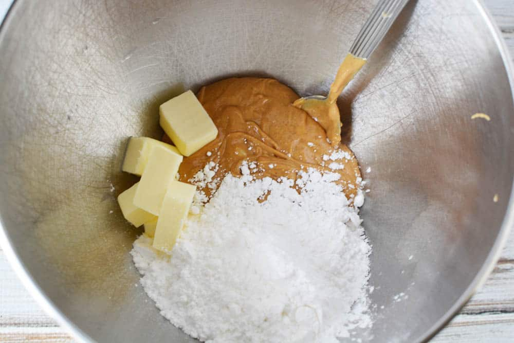 Peanut butter, butter and powdered sugar in a mixing bowl