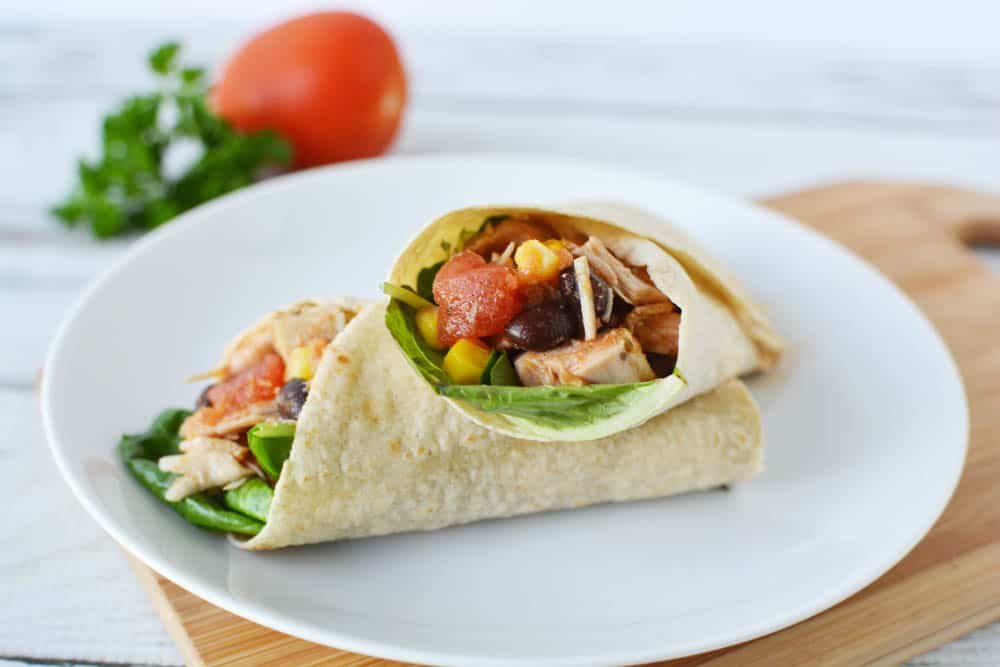 southwest chicken wraps cut in half on a plate